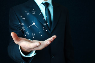Businessman holding clock. Business time management.